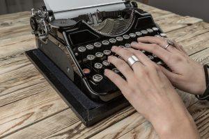 Writer Hands on old typewriter