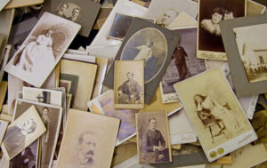 old family photos in a pile