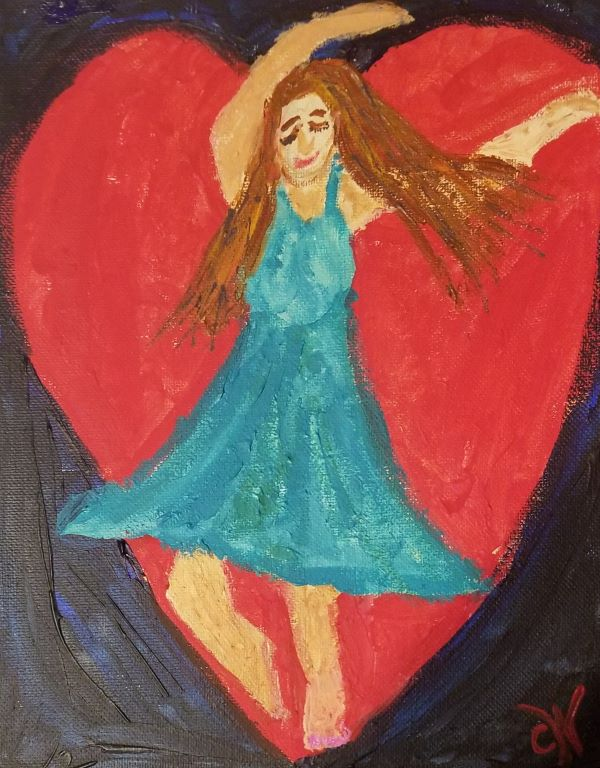 Woman in turquoise dress dancing in front of heart paiting